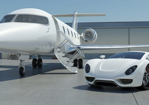 A modern sports car and private jet at an airport. My own unique car and corporate jet designs. Very high resolution 3D render.